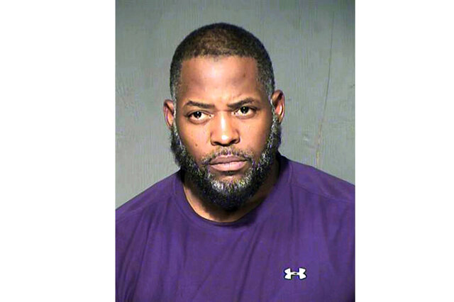 FILE - This undated file photo provided by the Maricopa County Sheriff's Department shows Abdul Malik Abdul Kareem. A federal judge refused to toss out the entire case against Kareem convicted of providing guns to and training two friends who attacked a Prophet Muhammad cartoon contest outside Dallas, but said this week he should be retried on a single count of transporting weapons across state lines.(Maricopa County Sheriff's Department via AP, File)