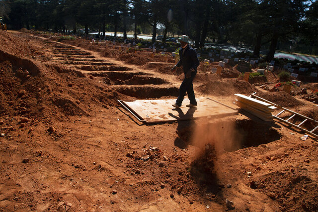 A grave is prepared for a Muslim burial at Johannesburg's main Westpark Cemetery, Tuesday, July 14, 2020. Graves are being prepared across the country as it faces a possible shortages of COVID-19 beds and oxygen supply as the country heads towards its coronavirus peak. (AP Photo Denis Farrell)