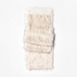 This photo shows the Threshold faux fur table runner. From tablescapes to apparel, the gift possibilities in white are endless for the holidays. (AP Photo/Target).