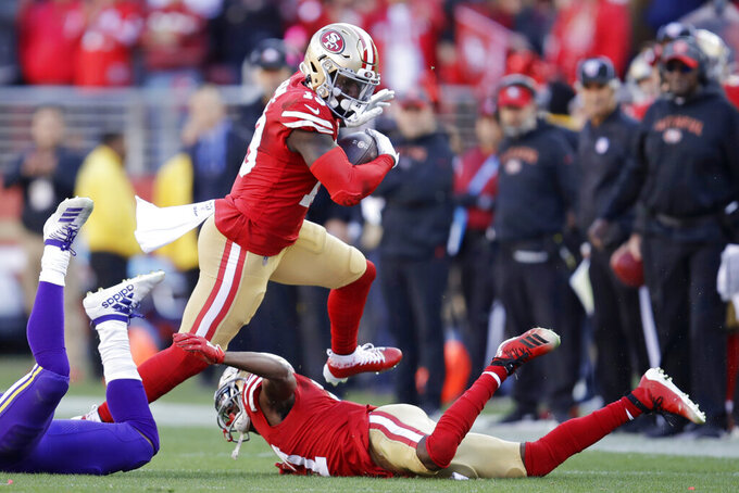 San Francisco 49ers wide receiver Deebo Samuel, center, runs against the Minnesota Vikings during the first half of an NFL divisional playoff football game, Saturday, Jan. 11, 2020, in Santa Clara, Calif. (AP Photo/Ben Margot)
