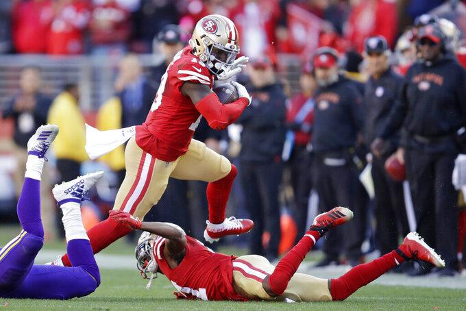 San Francisco 49ers wide receiver Deebo Samuel, center, runs against the Minnesota Vikings during the first half of an NFL divisional playoff football game, Saturday, Jan. 11, 2020, in Santa Clara, Calif. (AP Photo/Ben Margot)