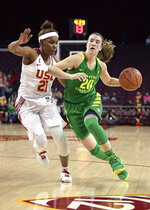 Oregon's Sabrina Ionescu, right, drives toward the basket as Southern California's Aliyah Mazyck defends during the first half of an NCAA college basketball game Friday, Jan. 11, 2019, in Los Angeles. (AP Photo/Mark J. Terrill)