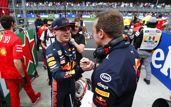 Red Bull driver Max Verstappen, of the Netherlands, celebrates his pole position with a members of his team during the qualifying session of the Formula One Mexico Grand Prix auto race at the Hermanos Rodriguez racetrack in Mexico City, Saturday, Oct. 26, 2019. (AP Photo/Eduardo Verdugo)