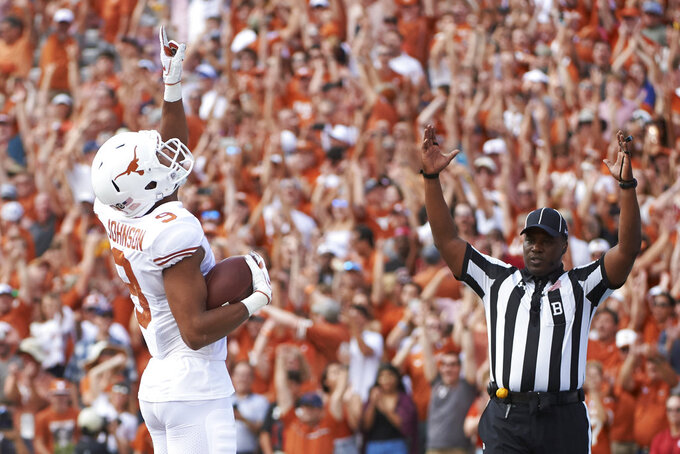 FILE- In this Saturday, Oct. 6, 2018, file photo, Texas wide receiver Collin Johnson (9) celebrates after scoring a touchdown on a 2-yard reception during the first half of an NCAA college football game against Oklahoma at the Cotton Bowl in Dallas. Johnson and Lil'Jordan Humphrey have been a big problem for opposing defenses. The duo has combined for 65 catches and eight touchdowns for the No. 9 Longhorns. (AP Photo/Cooper Neill, File)
