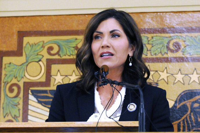 FILE - In this Jan. 2019 file photo, South Dakota Gov. Kristi Noem speaks in Pierre, S.D. Noem said in a statement Thursday, Oct. 24, 2019, that as part of the state's settlement with the American Civil Liberties Union, the state will not enforce parts of the laws that made it a crime to direct or encourage others to