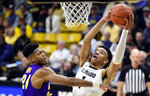 Colorado guard Tyler Bey, right, goes up to dunk the ball as Northern Iowa guard Isaiah Brown defends in the second half of an NCAA college basketball game, Tuesday, Dec. 10, 2019, in Boulder, Colo. (AP Photo/Cliff Grassmick)