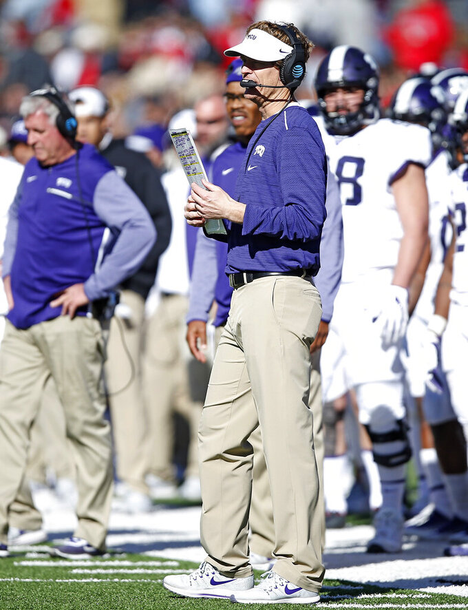 FILE - In this Nov. 18, 2017, file photo, TCU offensive coordinator Sonny Cumbie waits for the time out during the second half of the NCAA college football game against Texas Tech, Saturday,, in Lubbock, Texas. Texas Tech coach Matt Wells knew something had to change after a pair of four-win seasons with offenses not nearly up to par with what's expected from Tech fans, so Wells hired Sonny Cumbie as the new offensive coordinator. (AP Photo/Brad Tollefson, File)
