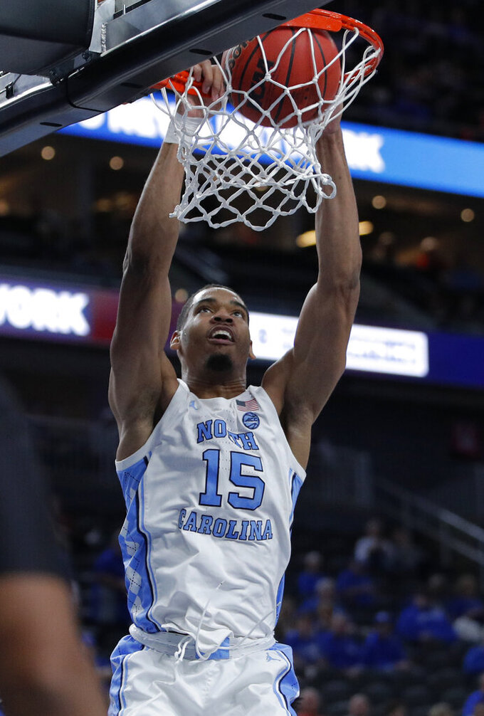 North Carolina's Garrison Brooks (15) dunks against UCLA during the first half of an NCAA college basketball game Saturday, Dec. 21, 2019, in Las Vegas. (AP Photo/John Locher)