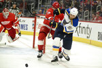St. Louis Blues right wing Vladimir Tarasenko, of Russia, shoots the puck away from Detroit Red Wings defenseman Filip Hronek of the Czech Republic in the first period of an NHL hockey game, Sunday, Oct. 27, 2019. (AP Photo/Jose Juarez)