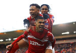 Middlesbrough's Ashley Fletcher celebrates scoring his side's first goal of the game with Marcus Tavernier, left, during their game against Tottenham, during their English FA Cup third round match at the Riverside Stadium in Middlesbrough, England, Sunday Jan. 5, 2020. (Owen Humphreys/PA via AP)
