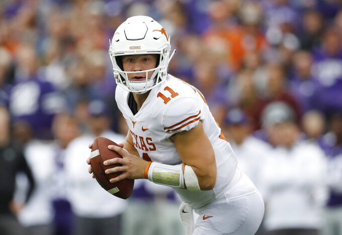 FILE - In this Sept. 29, 2018, file photo, Texas quarterback Sam Ehlinger looks for an open receiver during the second quarter of a college football game against Kansas State in Manhattan, Kan. Oklahoma's Kyler Murray, West Virginia's Will Grier, Iowa State's Brock Purdy and Sam Ehlinger of Texas have been impressive and could determine which teams makes it to the Dec. 1 title game in Arlington, Texas. (AP Photo/Colin E. Braley, File)