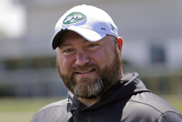 FILE - In this June 11, 2019, file photo, New York Jets general manager Joe Douglas greets reporters during a practice at the team's NFL football training facility in Florham Park, N.J. Douglas entered his first full offseason running the New York Jets armed with a clear plan. The general manager is setting a tone in free agency unlike that of the often free-spending Jets of recent years. He has made mostly modest deals with second-tier free agents with upside while trying to retool and restructure the roster. (AP Photo/Seth Wenig, File)