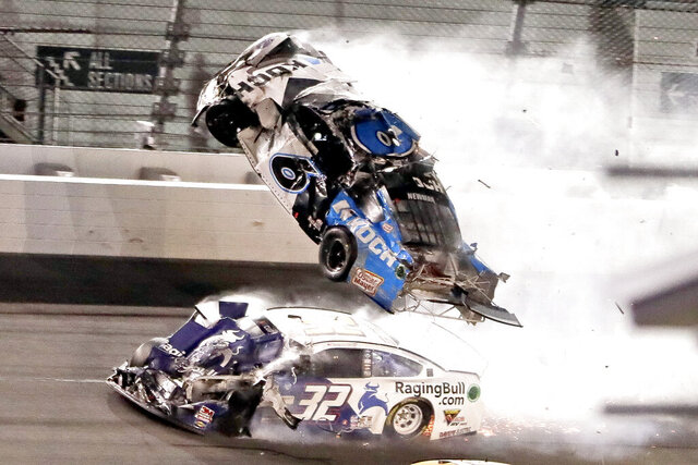 Ryan Newman (6) goes airborne as Corey LaJoie (32) crashes in to him on the final lap of the NASCAR Daytona 500 auto race at Daytona International Speedway, Monday, Feb. 17, 2020, in Daytona Beach, Fla. Sunday's race was postponed because of rain. (AP Photo/John Raoux)