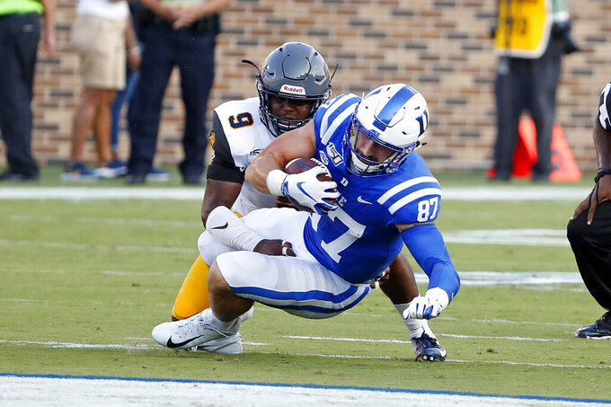 Duke's Noah Gray (87) gets tied up by North Carolina A&T's Antoine Wilder (9) during the first half of an NCAA college football game in Durham, N.C., Saturday, Sept. 7, 2019. (AP Photo/Karl B DeBlaker)