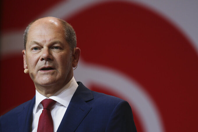 German Finance Minister Olaf Scholz attends a news conference in Berlin, Germany, Monday, Aug. 10, 2020. Olaf Scholz announces that he will run for the for the Social Democratic Party as chancellor candidate at next year's general elections in Germany.(AP Photo/Markus Schreiber)