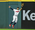 Cleveland Indians' Oscar Mercado catches a ball ht by Detroit Tigers' Victor Reyes during the seventh inning of a baseball game Thursday, July 18, 2019, in Cleveland. (AP Photo/David Dermer)