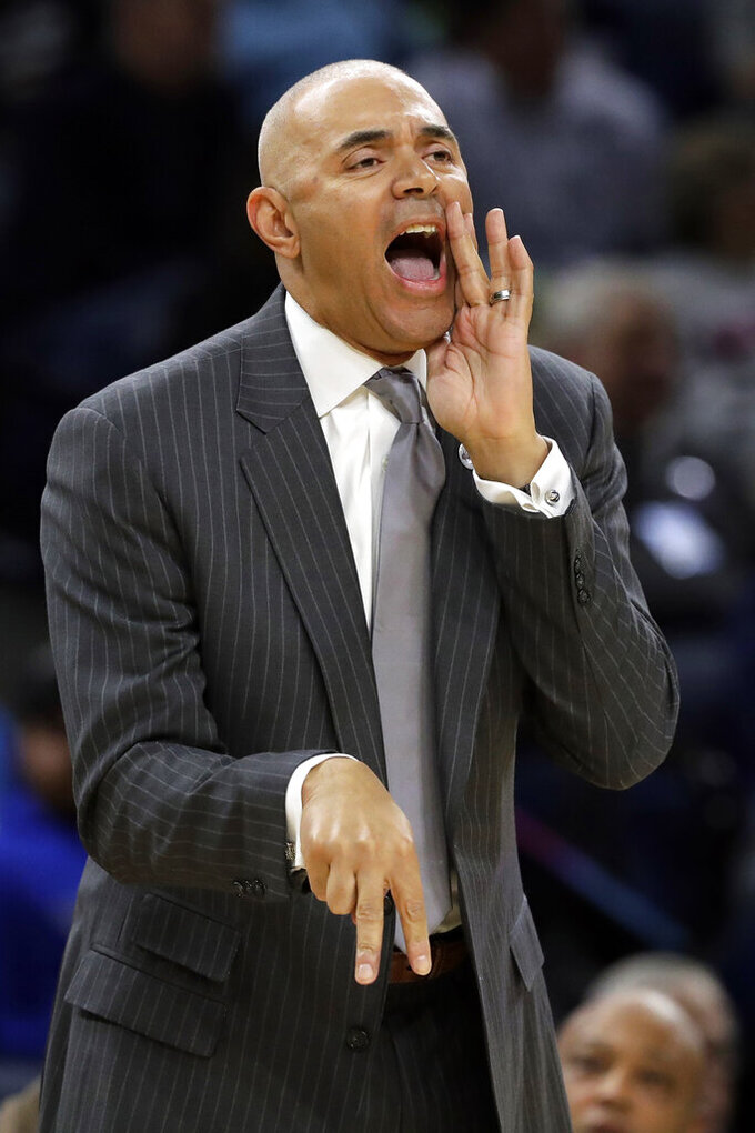 FILE - In this Nov. 15, 2018, file photo, DePaul coach Dave Leitao shouts to his team during the first half of an NCAA college basketball game against Penn State, in Chicago. The NCAA suspended men's basketball coach Dave Leitao for the first three games of the regular season Tuesday, July 23, 2019, saying he should have done more to prevent recruiting violations by his staff. The NCAA also put the Big East program on three years of probation, issued a $5,000 fine and said an undetermined number of games will be vacated because DePaul put an ineligible player on the floor. An unidentified former associate head coach is also facing a three-year show cause order for his role in the violations. (AP Photo/Nam Y. Huh, FIle)