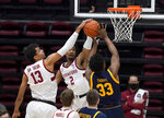 Stanford forward Oscar da Silva (13) blocks California forward D.J. Thorpe (33) during the first half of an NCAA college basketball game in Stanford, Calif., Sunday, Feb. 7, 2021. (AP Photo/Tony Avelar)