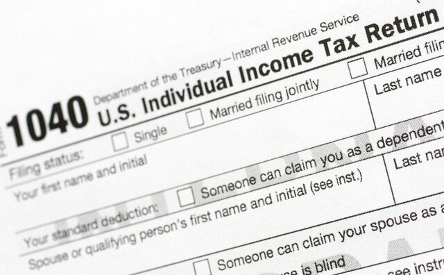 FILE - This July 24, 2018, file photo shows a portion of the 1040 U.S. Individual Income Tax Return form. Tax time is an inevitable reminder to organize important documents. Begin by knowing what to keep, and for how long. Then, decide on a system for finding the documents you need when you need them. Choose a method you'll feel confident using, whether that's digitizing everything or putting papers in a file cabinet.  (AP Photo/Mark Lennihan, File)