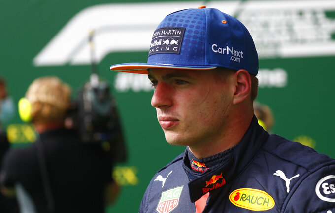 Red Bull driver Max Verstappen of the Netherlands walks in the paddock after placing third in the qualifying session prior to the Formula One Grand Prix at the Spa-Francorchamps racetrack in Spa, Belgium Saturday, Aug. 29, 2020. Mercedes driver Lewis Hamilton of Britain will take pole position for the race on Sunday. (Francois Lenoir, Pool via AP)
