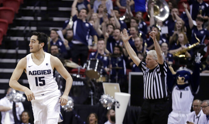 Utah State's Abel Porter (15) heads to the other end after sinking a 3-point shot during the second half of the team's NCAA college basketball game against Fresno State in the Mountain West Conference men's tournament Friday, March 15, 2019, in Las Vegas. (AP Photo/Isaac Brekken)
