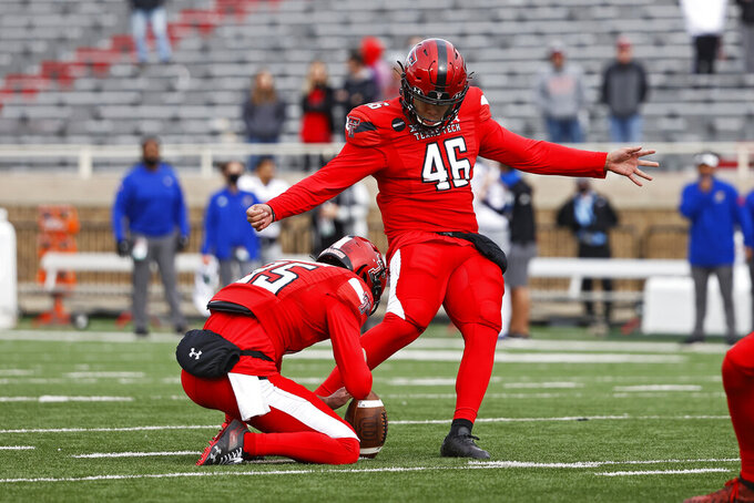 Texas Tech's Jonathan Garibay (46) kicks a field goal during the second half of an NCAA college football game against Kansas, Saturday, Dec. 5, 2020, in Lubbock, Texas. (AP Photo/Brad Tollefson)