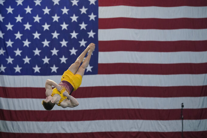 Michael Moran performs in the floor exercise during the Winter Cup gymnastics competition, Sunday, Feb. 28, 2021, in Indianapolis. (AP Photo/Darron Cummings)