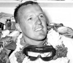 FILE - In this May 30, 1961, file photo, A.J. Foyt, still wearing his goggles and victory wreath, smiles in the garage area after winning the Indianapolis 500 auto race at Indianapolis Motor Speedway in Indianapolis, Ind. Tony Stewart had one favorite driver growing up and if he ever reached the same levels as A.J. Foyt, he hoped to emulate his hero. On the 60th anniversary of the first of Foyt's four Indianapolis 500 victories, Stewart will sit side-by-side next to his idol on the pit stand as Foyt's guest for the celebration.  (AP Photo/File)
