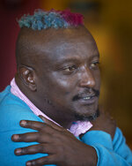 FILE - In this Wednesday, Jan. 22, 2014 file photo, prize-winning Kenyan author Binyavanga Wainaina talks during a television interview in Nairobi, Kenya. The chairman of the Kwani Trust which Wainaina founded said Wednesday, May 22, 2019 that the author and LGBT activist died Tuesday night in Nairobi. (AP Photo/Ben Curtis, File)