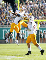 Arizona State's Chase Lucas, left, Timarcus Davis, center, and Jermayne Lole, right, celebrate after Michigan State missed a field goal during the second quarter of an NCAA college football game Saturday, Sept. 14, 2019, in East Lansing, Mich. (AP Photo/Al Goldis)