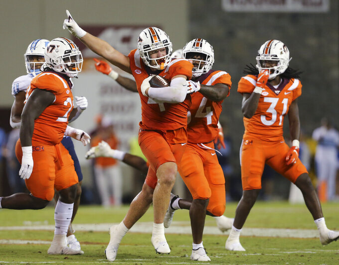 Virginia Tech's Dax Hollifield (4) celebrates his interception during the second half against North Carolina in an NCAA college football game Friday, Sept. 3, 2021, in Blacksburg, Va. (Matt Gentry/The Roanoke Times via AP)