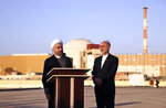 FILE - In this Jan. 13, 2015, file photo released by the Iranian Presidency Office, President Hassan Rouhani, left, speaks as he is accompanied by the head of Iran's Atomic Energy Organization Ali Akbar Salehi on a visit to the Bushehr nuclear power plant just outside the port city of Bushehr, southern Iran. Iran announced Sunday, July 7, 2019 it will raise its enrichment of uranium, breaking another limit of its faltering 2015 nuclear deal with world powers and further heightening tensions between Tehran and the U.S. (AP Photo/Iranian Presidency Office, Mohammad Berno)