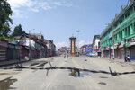 Kashmiri women walk at a deserted Lal Chowk square, a frequent site for anti-India protests, in Srinagar, Indian controlled Kashmir, Thursday, Aug. 8, 2019. The lives of millions in India's only Muslim-majority region have been upended since the latest, and most serious, crackdown followed a decision by New Delhi to revoke the special status of Jammu and Kashmir and downgrade the Himalayan region from statehood to a territory. Kashmir is claimed in full by both India and Pakistan, and rebels have been fighting Indian rule in the portion it administers for decades. (AP Photo/Sheikh Saaliq)