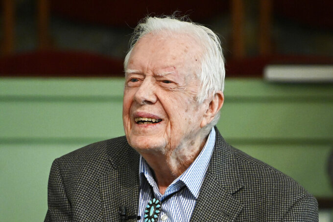 FILE - In this Nov. 3, 2019, file photo, former President Jimmy Carter teaches Sunday school at Maranatha Baptist Church in Plains, Ga. Carter is sometimes called a better former president than he was president. The backhanded compliment has always rankled Carter allies and, they say, the former president himself. Yet now, 40 years removed from the White House, the most famous resident of Plains, Georgia, is riding a new wave of attention as biographers, filmmakers, climate activists and Carter's fellow Democrats push for a recasting of his presidential legacy. (AP Photo/John Amis, File)