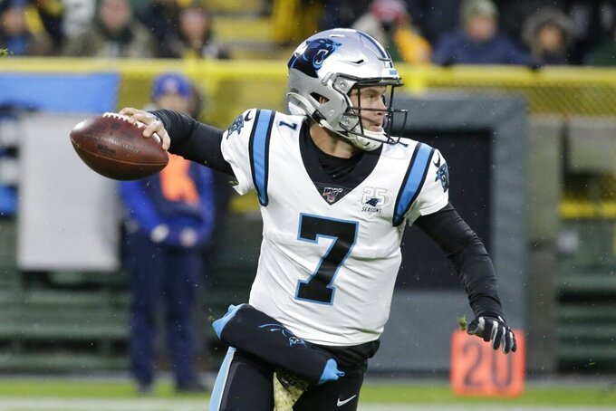 Carolina Panthers' Kyle Allen drops back during the first half of an NFL football game against the Green Bay Packers Sunday, Nov. 10, 2019, in Green Bay, Wis. (AP Photo/Mike Roemer)