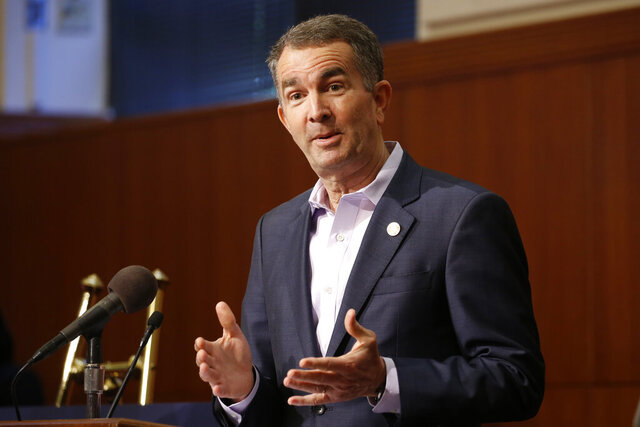 Virginia Gov. Ralph Northam gestures during a news conference at the Capitol Wednesday April 8, 2020, in Richmond, Va. Northam gave an update on his COVID-19 plans. (AP Photo/Steve Helber)
