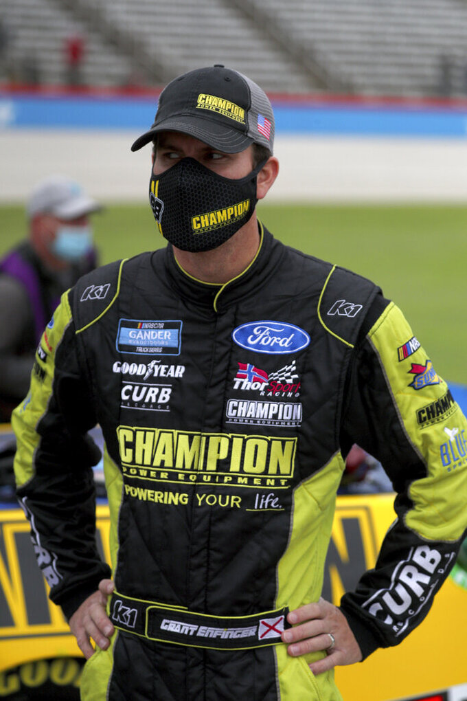 NASCAR Texas Trucks Series driver Grant Enfinger (98) stands on pit road before a NASCAR Cup Series auto race at Texas Motor Speedway in Fort Worth, Texas, Sunday, Oct. 25, 2020. (AP Photo/Richard W. Rodriguez)