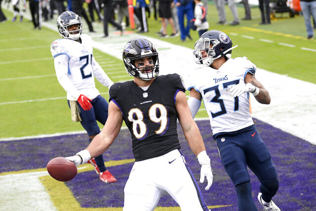 Baltimore Ravens tight end Mark Andrews (89) reacts after scoring on a touchdown pass from quarterback Lamar Jackson, not visible, during the second half of an NFL football game against the Tennessee Titans, Sunday, Nov. 22, 2020, in Baltimore. Titans' Amani Hooker (37) and Malcolm Butler (21) look on. (AP Photo/Nick Wass)