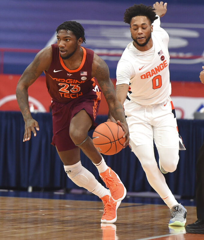 Syracuse forward Alan Griffin (0) chases Virginia Tech guard Wabissa Bede (3) during an NCAA college basketball game at the Carrier Dome, Syracuse, N.Y., Saturday Jan. 23, 2021. (Scott Schild/The Post-Standard via AP)