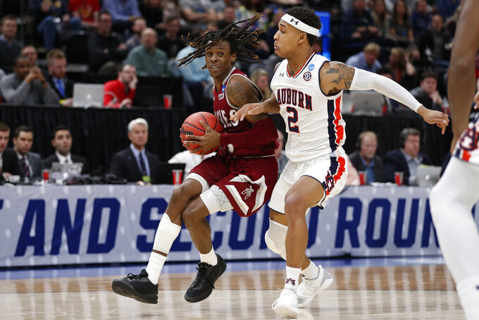 New Mexico State guard Terrell Brown, left, drives to the hoop against Auburn guard Bryce Brown (2) in the first half during a first round men's college basketball game in the NCAA Tournament Thursday, March 21, 2019, in Salt Lake City. (AP Photo/Jeff Swinger)