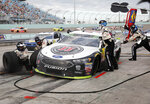 Kevin Harvick makes a pit stop during the NASCAR Cup Series championship auto race at Homestead-Miami Speedway, Sunday, Nov. 18, 2018, in Homestead, Fla. (AP Photo/Terry Renna)
