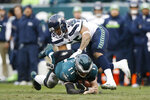 Philadelphia Eagles' Carson Wentz (11) is tackled by Seattle Seahawks' Mychal Kendricks (56) during the second half of an NFL football game, Sunday, Nov. 24, 2019, in Philadelphia. (AP Photo/Michael Perez)