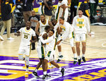 Norfolk State players celebrate after beating Morgan State in an NCAA college basketball game in the championship of the Mid-Eastern Athletic Conference tournament at the Scope Arena on Saturday, March 13, 2021, in Norfolk, Va. (AP Photo/Mike Caudill)