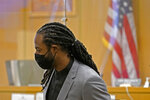 Richard Sherman stands up to leave a King County District Court hearing, Friday, July 16, 2021, in Seattle. The NFL football cornerback, who has played with the Seattle Seahawks and the San Francisco 49ers, was arraigned on five criminal charges Friday after he was arrested Wednesday after police said he crashed his car in a construction zone along a busy highway east of Seattle and then tried to break into his in-laws' home in the suburb of Redmond, Wash. (AP Photo/Ted S. Warren)