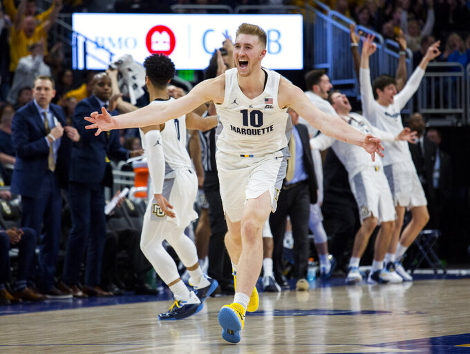 Marquette forward Sam Hauser reacts after making a three-point basket against Providence late in the second half of an NCAA college basketball game Sunday, Jan. 20, 2019, in Milwaukee. (AP Photo/Darren Hauck)