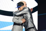 Jalen Suggs hugs NBA Commissioner Adam Silver after being selected fifth overall by the Orlando Magic during the NBA basketball draft, Thursday, July 29, 2021, in New York. (AP Photo/Corey Sipkin)