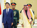 In this photo released by the Saudi Royal Palace, Saudi King Salman, right, receives Japan's Prime Minister Shinzo Abe, in Riyadh, Saudi Arabia, Sunday, Jan. 12, 2020. (Bandar Aljaloud/Saudi Royal Palace via AP)