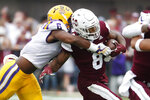 Mississippi State running back Kylin Hill (8) is tackled by LSU linebacker Jacob Phillips (6) during the first half of their NCAA college football game in Starkville, Miss., Saturday, Oct. 19, 2019. LSU won 36-13. (AP Photo/Rogelio V. Solis)