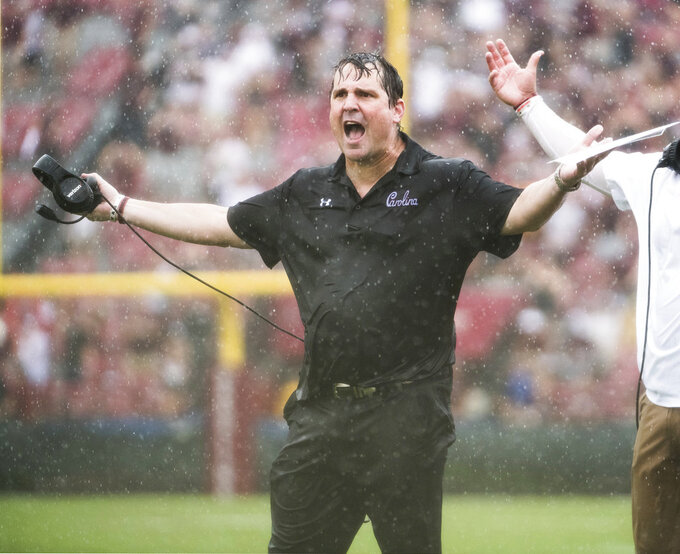 FILE - In this Oct. 6, 2018, file photo, South Carolina head coach Will Muschamp reacta to an official's call during the second half of an NCAA college football game against Missouri, in Columbia, S.C. Back from a week off, South Carolina faces Tennessee on Saturday, Oct. 27. (AP Photo/Sean Rayford, File)