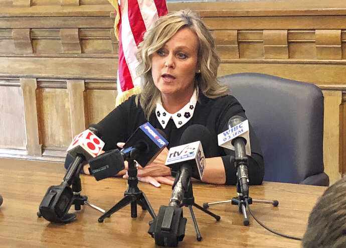 FILE  - In this May 13, 2019, file photo, Indiana state schools Superintendent Jennifer McCormick speaks during a news conference at the Statehouse in Indianapolis. Students in Indiana will return to school this fall, but what that looks like will vary widely across the state.  Following the Indiana Department of Education's release of school reentry guidelines last week,  McCormick addressed teachers and administrators during a webinar, emphasizing the freedom local leaders have to determine how their schools will operate during the coronavirus pandemic.  (AP Photo/Tom Davies, file)